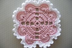 Ravelry: Hearts Around Doily pattern by Terri Kroupa; free