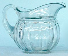 A large clear signed Heisey Colonial pattern glass water pitcher, applied arched handle, simple round foot.