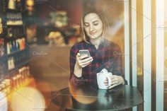 Smiling hipster girl using cellphone by FlyingFife on @creativemarket