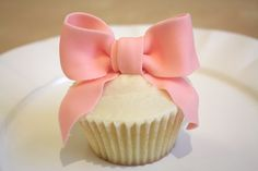 cute for a baby shower or revealing the gender - cupcake with a pink bow on top
