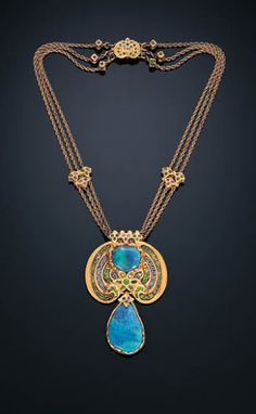 A BLACK OPAL, DEMANTOID GARNET, SAPPHIRE & ENAMEL NECKLACE by LOUIS COMFORT TIFFANY set with a black opal, within a circular-cut demantoid garnet, sapphire & gold bead scroll mount, enhanced by a demantoid garnet floret, suspending a black opal pendant, within a textured gold foliate mount, reverse of green, blue & orange enamel foliate design, joined to a three-row gold rope chain, with clasp & enhancers of similar motif, circa 1915-1920