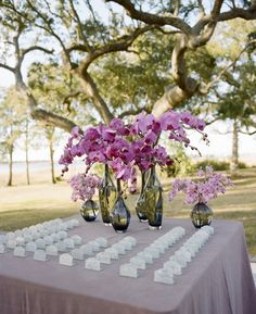 Purple Escort Card Table | photography by http://www.abryanphoto.com/