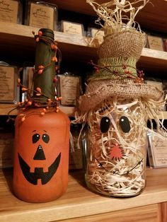 Pumpkin scarecrow painted wine bottles #recycledwinebottles #artprojects