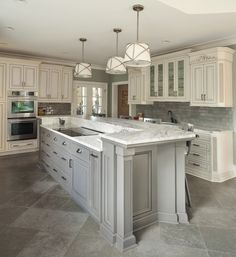 Plantation #kitchen with grey island & tile backsplash | Cultivate.com