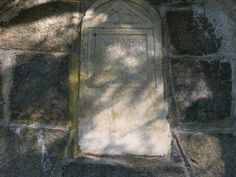 One of the many tomb stones in the walls