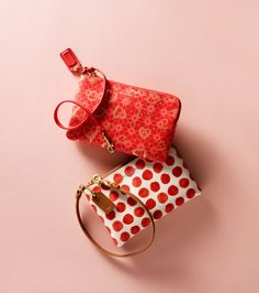 The Waverly Hearts Small Wristlet and the Bleecker Small Wristlet in Painted Dot from Coach