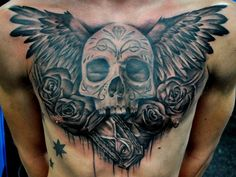Incredible black & gray work in this chest piece!
