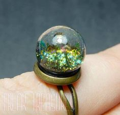 Magic adjustable ring, in the 12mm diameter sphere are floating gorgeous and precious color shifting pigments! This is a made to order item, so it