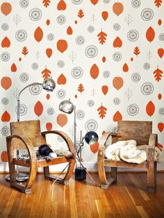 The blue-gray designs of the wallpaper counterbalance the bold orange leaves and rustic furniture, creating a harmonious space. The leaf motifs mimic foliage from common American trees, enhancing the natural look. Image courtesy of Juju Papers Art Deco Furniture, Rustic Furniture, Handmade Wallpaper, Doors And Floors, Paper Wallpaper, Orange Wallpaper, Kids Wallpaper, Wallpaper Ideas, Look Retro