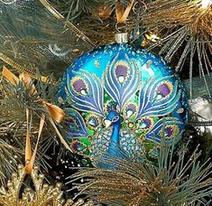 I have this ornament! Peacock Christmas Tree, Peacock Ornaments, Beaded Christmas Ornaments, Painted Ornaments, Blue Christmas, Christmas Balls, Christmas Colors, Christmas Themes, All Things Christmas
