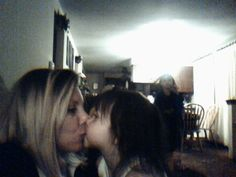 """A friend of mine was taking a picture of herself and her daughter kissing and in the background you can clearly see a figure that was not there. She had """"ghost experts"""" come in and check around the house and found nothing. After some research they found one of the previous owners was a mortician or ran a funeral home or something. I have known this girl for years and it would completely shock me if this was fabricated as I saw how upset she was and how much money she dished out for experts."""