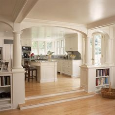 Might be a good way to deal with load bearing walls. use of columns and built in bookcases for kitchen/living room separation while keeping...