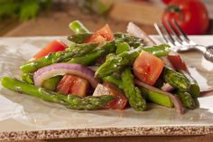 Here's a salad that's full of fresh taste and bright color! Our recipe for Asparagus and Tomato Salad is full of nutrition, too! Serve this flavor-filled, low-carb salad anytime of the year and your whole family will cheer!