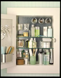 To maximize space in a traditional medicine cabinet, line the inside back of the cabinet and door with sheet metal, then use magnetic containers and hooks to hold supplies.