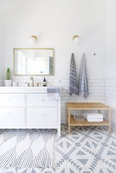 Beautifully designed gray and white bathroom features an Urban Outfitters Plum & Bow Connected Stripe Rag Rug placed on Cement Tile Shop Tulum II Tiles in front of an Ikea Hemnes/Odensvik Washstand adorning Marble White Disc Drawer Pulls and a brass fa Decor, House Design, Gray And White Bathroom, Interior, Modern Small Bathrooms, Home Remodeling, Small Bathroom Tiles, Home Decor, House Interior