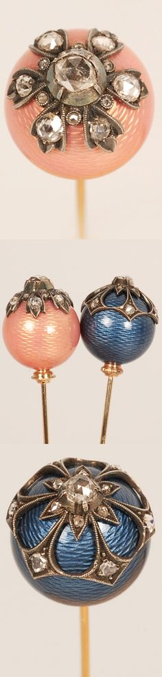PAIR OF HATPINS A pair of Russian gem-set gold and guilloche enamel hatpins, unmarked, ST Petersburg, circa 1900. Each pin topped by a round bead in either blue or pink guilloche enamel accented by mine-cut diamonds set in white gold mounts. Length: 4″ (10.2 cm)