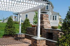Outdoor space designed by @TheWordGroupInc, thewordgroupinc.com #landscapedesign #outdoorroom #pergolas #outdoorfireplace