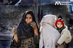 December 30:  A family sticks together at a refugee camp near Jalalabad, Afghanistan.    Photo: Kate Holt, International Medical Corps, Afghanistan 2009