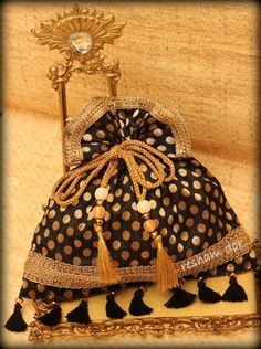 RD 1030 – Raina Raina-the night! Classic handwoven potli in black and   gold.Completes every wardrobe.  Price: Rs.1990
