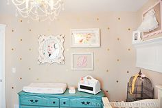 Love this photo wall in baby Lily's shabby chic nursery! | See the rest of Lily's room at One Small Child: www.onesmallchild.com