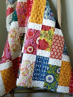 Modern Lap Quilt- Folk Song Quilt  This quilt has sold but I would love to make one just like it for you. Please allow 1-2 weeks for your quilt to be made before shipping. This quilt features fabrics from Anna Maria Horners Folk Song collection in a saturated, modern palette of pinks, reds, teals, golds, and blues. It is quilted in cream thread in a meandering wavy pattern. The binding is made from a deep teal floral print from the Folk Song collection and is machine stitched to both sides…
