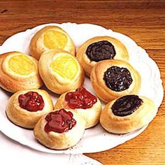 Kolaches--learned to make these from a lovely English neighbor when I was 13.  We would drizzle them with a light powder sugar frosting.  I have got to make some of these soon- Cherry Kolaches!!