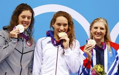 Schmitt (USA), Muffat (FRA), and Adlington (GBR) pose with their medals during the Women's 400m Freestyle victory ceremony July 29.