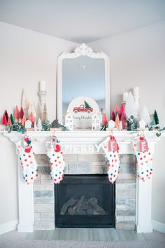 We are sharing the ultimate round up of our favorite bottle brush trees in one spot! We LOVE decorating with bottle brush trees and they can add such a fun and colorful touch to any room. The perfect Christmas decor! #christmas #christmasdecor #bottlebrushtrees #christmasdecorations #mantledecor #christmasmantle