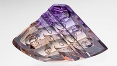 Dyber optic dishes give the appearance that this 216.06 ct ametrine from Bolivia is bubbling with bubbles. Photo by Robert Weldon/GIA, courtesy of Michael M. Dyber, gem designer