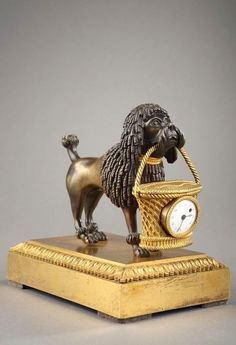 Empire Mini Poodle Clock original pendulum in gilded and patinated bronze of the imperial era.