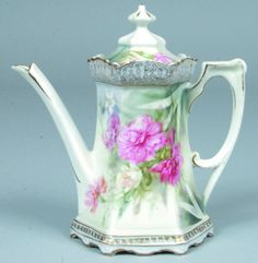 "RS Prussia Coffee Pot, 5.5""h.; Mold 577; Pink and white carnations with shadow leaves, blue accents with surreal dogwood compliment, gold stencil borders to rim and base"