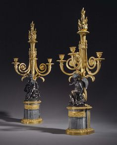 A PAIR OF LOUIS XVI ORMOLU, PATINATED BRONZE AND BLEU TURQUIN MARBLE THREE-BRANCH CANDELABRA
