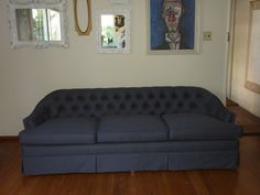 Reupholstered 3 Cushion Tufted Back Sofa done in a Blue Denim Fabric.