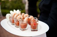 Wedding guests enjoyed a number of tray-passed hors d'oeuvres throughout the pre-ceremony cocktail hour, including shrimp cocktail. Photography: Elizabeth Solano. Read More: http://www.insideweddings.com/weddings/seaside-wedding-at-the-resort-pelican-hill-newport-beach/394/