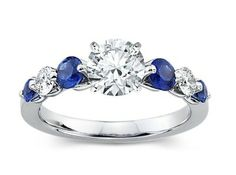 Round Diamond Engagement Ring with Sapphire Side Stones in Platinum tcw. Round Diamond Engagement Ring with Sapphire Side Stones in Platinum tcw. The Sapphires, Sapphire Diamond, Oval Diamond, Sapphire Rings, Diamond Rings, Orange Sapphire, Round Diamond Engagement Rings, Eternity Ring, Beautiful Rings