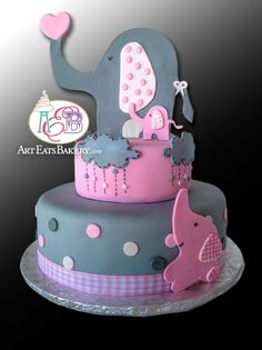 Creative custom girl's pink and gray fondant elephants and clouds baby shower cake design with edible topper