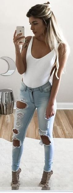 White Bodysuit + Ripped Jeans                                                                             Source