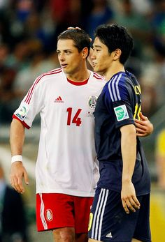 Chicharito and Shinji Kagawa after their match up in the Confederations Cup