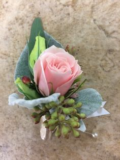 pink spray rose with lisianthus, wax flower, eucalyptus, and dusty miller accents