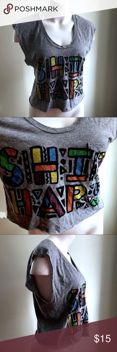 """Urban Outfitters Shit Haps Muscle Crop Tank Top Urban Outfitters Truly Maddly Deeply Grey Shit Haps Muscle Crop Tank Top Sz SX S   Brand: Truly Maddly Deeply Size: XS Condition: pre-loved Material: cotton blend  •Shit Haps graphic on front •muscle style, cropped •has stretch •pocket in front •distressed  Measurements laying down: Chest: 16"""" Center length (shoulder to hem): 17""""  Product ID 3-bia-0218 Urban Outfitters Tops Muscle Tees"""