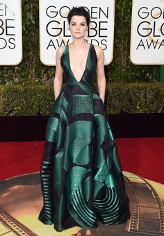 Jaimie Alexander took the plunge in a black Genny dress with green geometric details (and pockets!). She also rocked a bevy of Lorraine Schwartz emeralds. See more of the Golden Globes' best dressed stars here!