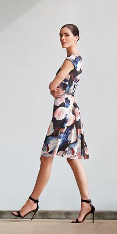 Step out this summer in #StJohnKnits watercolor blossoms silk dress from the #PreFall 2015 collection. | sjk.com
