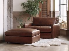 Shop the Kipton Collection at Arhaus. Ottoman In Living Room, Chair And Ottoman, Home Living Room, Living Room Furniture, Leather Furniture, Furniture Sale, Leather Ottoman, Small Space Living, Upholstery