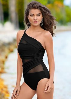 Wish I could spent 2016 in this hot-looking gorgeous bathing suit and walk the beach in front of my 4-bedroom, 3-baths beach home located in some hot weather state... preferably on the coast of Florida.  How great would that be!