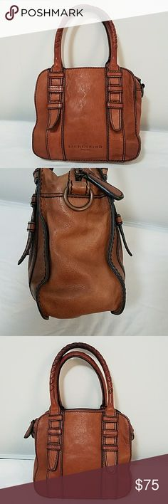 Liebeskind Berlin Vintaged Cognac Leather Satchel Lovely Liebeskind Berlin Leather (Vintaged like Frye) Cognac Color Satchel.bag has zip interior, two slip wall pockets on one side and one zip, and one large slip pocket on other side. Handles are braided leather and shoe some discoloration at top see pics. There are couple of light ink marks at zip opening but hardly noticeable. The strap is missing but overall Good used condition and smoke free home! Measures 8.5in Tall. 10in Wide, 4in…