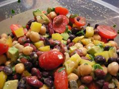 Peruvian Bean Salad:  15 minutes prep time!  This beautiful salad is loaded with colorful vegetables and beans. It's an ideal dish to bring to a pot luck or buffet as it can sit for hours and it's flavor only improves. I love the addition of the avocado. It makes it unlike other bean salads I've tried.   http://www.food.com/recipe/peruvian-bean-salad-455254