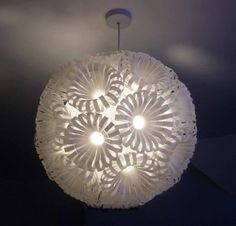 lamp shade made with recycled plastic bottles Reuse Plastic Bottles, Plastic Bottle Crafts, Recycled Bottles, Recycled Lamp, Plastic Waste, Plastic Cups, Diy Luminaire, Bottle Chandelier, Origami Lamp