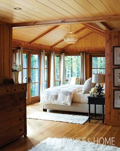 Summer Home Decorating Ideas Inspired by Rustic Simplicity of Canadian Cottages Enclosed Cottage Porch (© Janet Kimber). This has lots of elements I'd love- french doors, wood beams Inspired Homes, House Design, House, Lodge Bedroom, Interior, Home, Home Bedroom, House Interior, Rustic House
