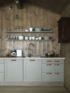 As much as I adore gourmet kitchens, I love charming, cozy, cottage kitchens just as much! I'm enamored with the stacks of bowls, plates and cups that are pl Log Cabin Kitchens, Cottage Kitchens, Home Kitchens, Rustic Kitchens, Cozy Kitchen, Kitchen Dining, Kitchen Cabinets, Kitchen Wood, Grey Cabinets