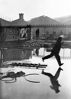Timing is everything, masterfully captured by Henri Cartier Bresson.